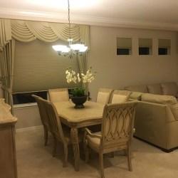 Living room-Dining room open concept, with elegant window treatments and 3M hurricane window treatments (photo credit: Windermere Sun-Susan Sun Nunamaker)