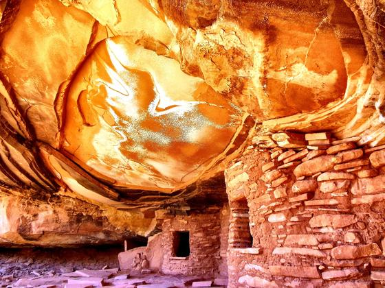 Historical and Cultural Winner, by David Regala-Cedar Mesa, refracted sunlight funnels into this Anasazi alcove conjuring an ephemeral glow.