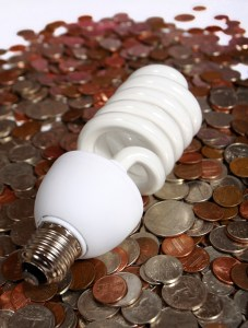 saving money cfl-and-coins- by Claudio Jule