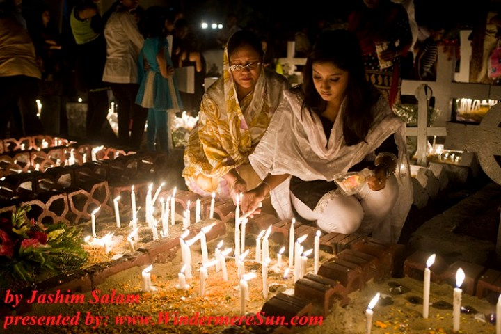 halloween-bangladeshi-girl-and-her-motherlighting-grave-candles-on-the-headstone-of-a-deceased-relative-in-the-city-of-chittagong-for-the-observance-of-allhallowtideby-jashim-salamjpg-final