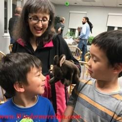 Bonnie Charyn w/kids (the puppet master) with her puppet (credit: Windermere Sun-Susan Sun Nunamaker)
