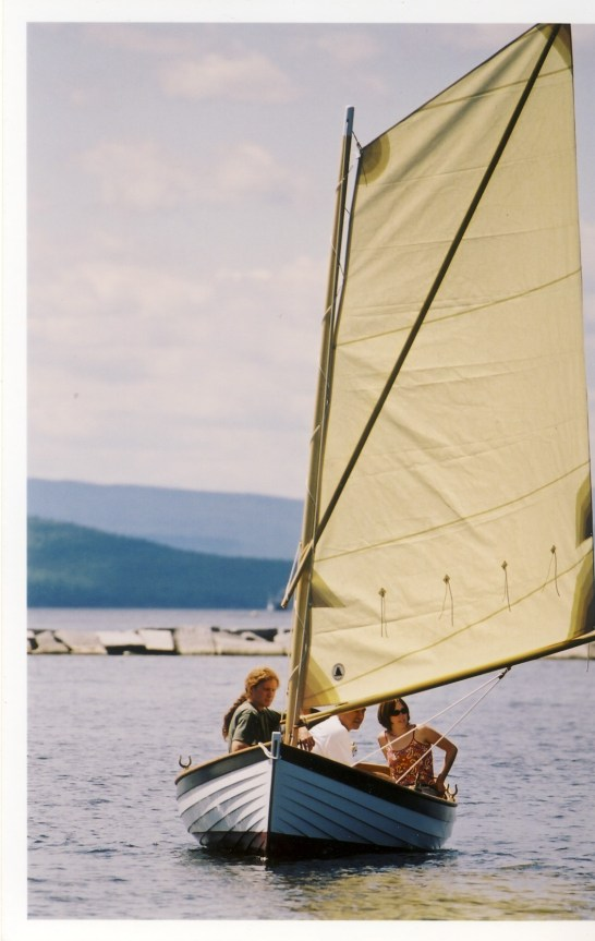 Wooden row boat and sail boat by Windfall Woodworks
