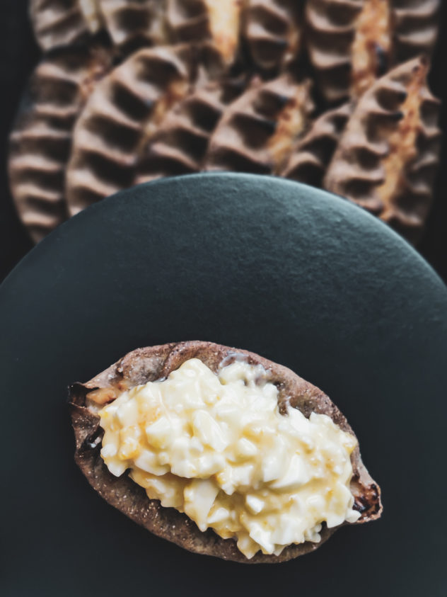 "Karelian pies are typically served with ""Munavoi"", a mixture of boiled eggs and salted butter"