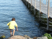 Boy Playing by Dock