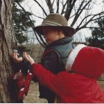 Children tapping a tree