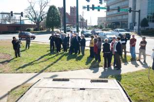 Brenau faculty, staff and community members stop to watch as Oak Hill Memorials of Elberton lowers the tiger onto her granite table top.