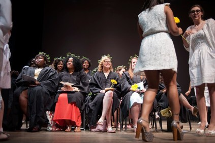 Women's College senior Alyson Shields, center, smiles as the sophomore class presents their sister class with yellow Gerber daisies. The senior and sophomore sister class colors are yellow and blue.