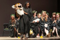 Mycharia Spurling is revealed as H.J. the tiger to the Women's College to student sin Pearce Auditorium during the Class Day at Brenau University's Alumnae Reunion Weekend. During the program the student who was secretly portraying H.J. for the year is unmasked.