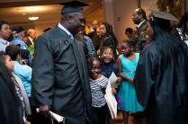 Vincentia Mensah and Asante Collins congratulate Francis Alu-Mensah after he graduated from Brenau University Saturday.