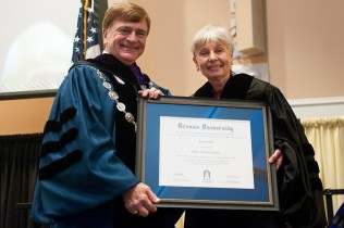 Brenau University President Ed Schrader presents commencement speaker Eleanor Clift with an honorary degree of Doctor of Humane Letters before she addressed the 2013 graduating students in the undergraduate and graduate programs Saturday.
