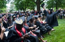 Lovely Daniels, right, throws her arms up in celebration after she and the rest of the 2013 Brenau University Women's College graduates moved their tassels across their hats signifying that they have graduated.