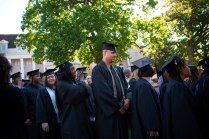 Graduates of Brenau University's nursing program work their way to the commencement ceremony.