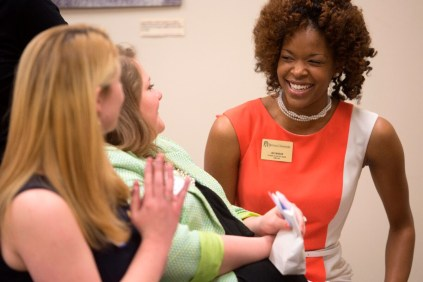 Brenau University's Lea Mason laughs with her fellow students during Lee Anne Romberg White's portion of the Women's Leadership Colloquium.