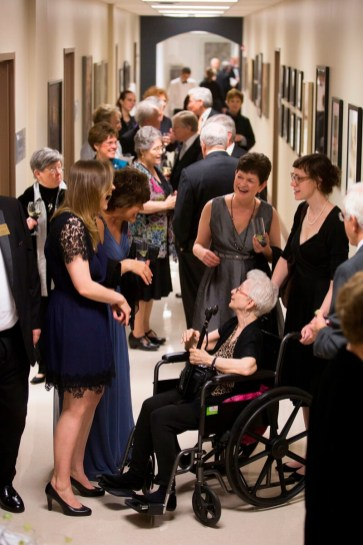 Renowned modern art collector Dorothy Vogel, sitting in the wheelchair, speaks with students and guests at the Brenau Gala. The Gala was held at the Brenau Downtown Center and was the official opening of the Manhattan Gallery where the gift of modern artwork donated by Dorothy from the collection she amassed with her husband hangs.