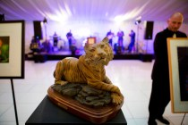 A maquette of the bronze tiger statue, Lucile, is placed on the dance floor under the tent before the start of the live auction at the Brenau Gala.