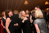 Matt and Becky Nix, center, of Duplicating Products in Gainesville, dance under the tent to Nu Soul during the Brenau Gala.