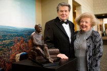 Abit and Kayanne Massey, a Brenau Women's College alumna, pose for a photo next to the statue of President Franklin Roosevelt they donated to Brenau University during the Brenau Gala.