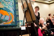 Dorothy Vogel, right, tours through the silent auction at the Brenau Gala with Brenau student Jordan Ligon.