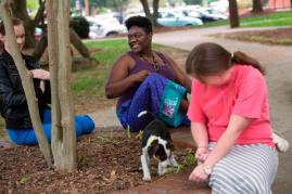 Jondell Taylor, an English junior at Brenau, smiles as she and her fellow Brenau students take a break from finals to play with puppies from the Hall County Animal Shelter.