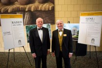 Brenau Trustees Chairman Peter Miller, left, and Brenau University President Ed Schrader, right, stand beside the display about the university's long-term captial campaign at the Brenau Gala at the Downtown Center.