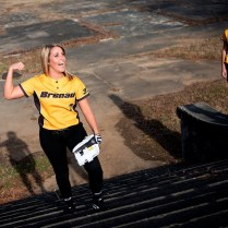 Brenau University softball player Cheyenne Marsh shows some muscle during a photo shoot on the future site of the Brenau University Athletic Complex next to the Milliken plant in Gainesville, Ga.