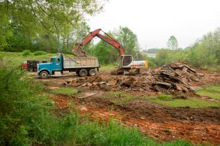 Crews clear concrete and trees from the site of the future Brenau Athletic Complex.