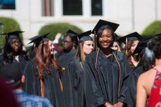 Devony Hemingway smiles as she processes out to the 2015 Women's College Commencement.