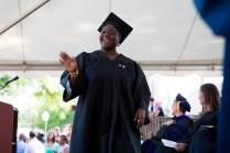 Jondell Taylor waves to friends and family as she graduates with a Bachelor of Science degree during the Brenau Women's College 2015 Commencement.