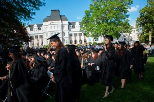 Dominika Jasova, left, walks to the podium during the 2015 Brenau Women's College Commencement. Jasova graduated with a Bachelor of Business Administration Degree.