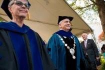 Brenau University President Ed Schrader process out from graduation alongside Provost Nancy Krippel.