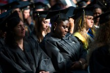 Jondell Taylor bows her head among her fellow 2015 Women's College graduates.