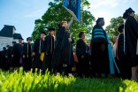 Brenau faculty members process onto the front lawn during the 2015 Undergraduate and Graduate Commencement.