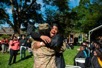 Debra Cooper screams as she hugs her daughter Staff Sgt. Markita James who told her mother she would still be in the Middle East during her mother's graduation.