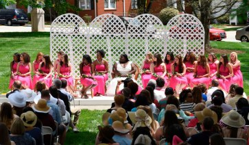 Members of the May Day Court listen to an awards presentation on the Front Lawn Saturday, April 11, 2015 in Gainesville, Georgia. (Photo Barry Williams / Brenau University)