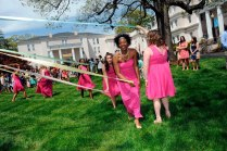 Brenau University student Devony Hemingway, middle, and the May Court participate in the Maypole tradition during May Day Saturday, April 11, 2015 in Gainesville, Georgia. Photo Barry Williams/ Brenau University)
