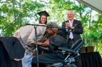 """Grandma"" DeBerne Kelly kisses her granddaughter Byronica Banks after she was awarded an honorary degree during the 2015 Brenau Women's College Commencement."