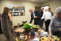 Guests sample the food and enjoy the artwork of Dennis Campay at the open house for Brenau University's new Jacksonville campus.