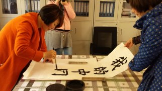 "The principal of one school we visited demonstrates how to paint Chinese calligraphy. This beautiful example, which says ""Your China Dream,"" is now on the wall of my office here at home."