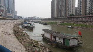 This photo shows houseboats along the Quingyi River, which was a small tributary of the Yangtze that divided Wuhu into northern and southern districts. Wuhu's importance as one of the last Yangtze River ports before Shanghai and the ocean has made it a trading center for literally thousands of years.
