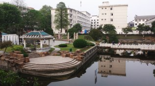 This photo shows a garden and study area on the old campus of Anhui Normal University. This section of ANU was founded in 1928 and is one of the oldest universities in China. In the background, several student dormitories can be seen.