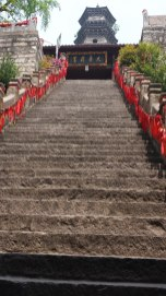 This photo shows the staircase leading up from the lower level of Guangji Monastery to the upper area with its 1,000-year-old tower. This staircase was reserved for going up, with two side staircases for walking down. Any visitor unaware of the customs for using the proper staircase could expect a quick correction form one of the older ladies who helped to clean the temple each day.
