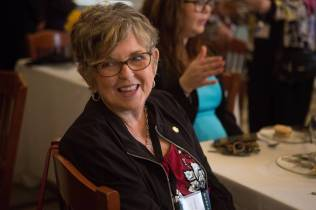 Julia Murchison Barker, WC '66, laughs at the 24 Karat Gold Club & Golden Roses Tea on Friday, April 15, 2016, in Gainesville, Ga. (AJ Reynolds/Brenau University)