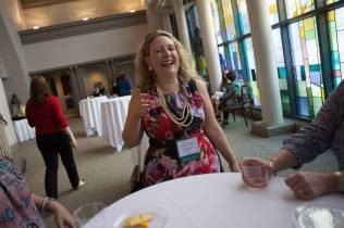 Susan Papesh, WC '06, laughs at the Wine & Cheese Opening Reception on Friday, April 15, 2016, in Gainesville, Ga. (AJ Reynolds/Brenau University)