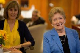 """Clara Martin smiles as her daughter Dorothy """"Dottie"""" Martin Corey, WC '78, sits behind her during an event celebrating her during the Brenau University Alumnae Reunion Weekend on Saturday, April 16, 2016, in Gainesville, Ga. (AJ Reynolds/Brenau University)"""