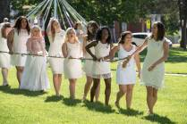 Women's College underclassmen carry an ivy and daisy draped rope while paying homage to the senior class on May Day, 2016 Alumnae Reunion Weekend