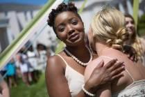 May Court member Anna-Marie Jordan hugs May Queen MK Jabbia during the Brenau University Alumnae Reunion Weekend on Saturday, April 16, 2016, in Gainesville, Ga. (AJ Reynolds/Brenau University)