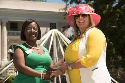Marsha Stringer, WC '96, BU '03, '05 awards Samantha Sumner, WC '09, the Young Alumni Award. 2016 Alumni Reunion Weekend