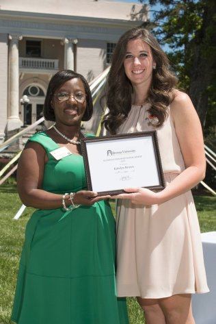 Marsha Stringer, WC '96, BU '03, '05 awards Katelyn Brown the Alumnae Endowed Scholar Award. 2016 Alumnae Reunion Weekend