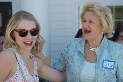 Carole Ann Daniel, an Alpha Delta Pi Lambda Past President and Brenau Trustee, right, hugs Katie Barth, WC '14, before the dedication of the Alpha Delta Pi sorority house during the Brenau University Alumnae Reunion Weekend on Saturday, April 16, 2016, in Gainesville, Ga. (AJ Reynolds/Brenau University)
