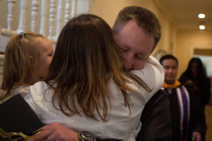 Gary Chewning gets a hug after the Brenau University College of Health Sciences Graduate Hooding Ceremony on Thursday, May 5, 2016. (AJ Reynolds/Brenau University)